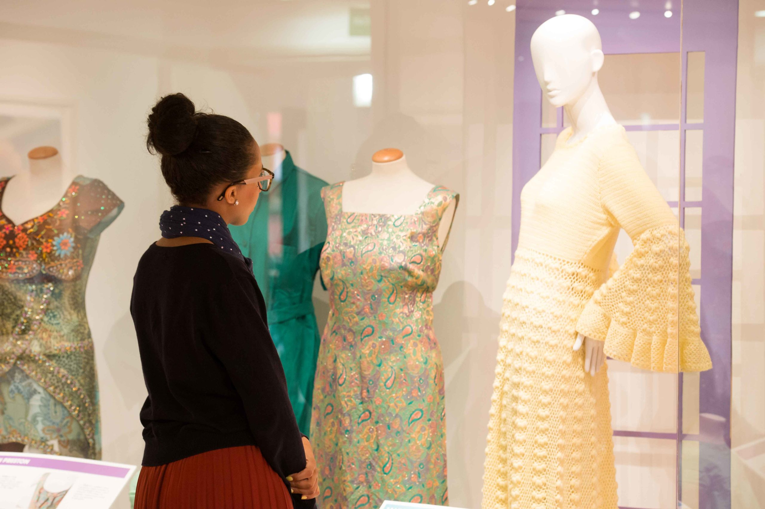 A visitor looks at some of the costumes on display at the Harris