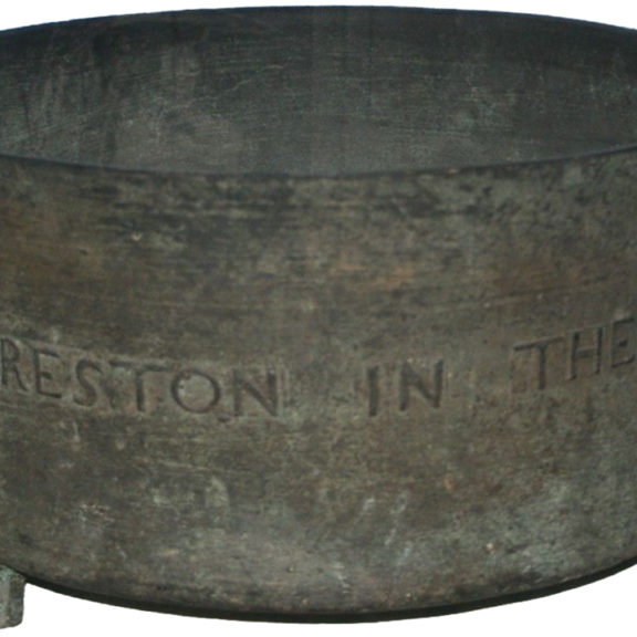 Iron basin with the words 'Preston in the...' engraved on it