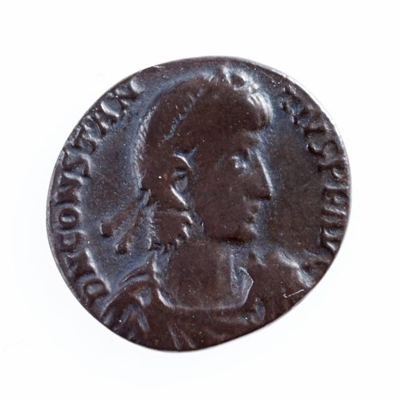 A Roman's silhouette carved onto a coin.
