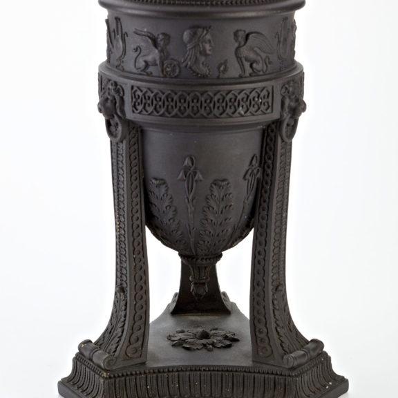 dark coloured ornate basin with decorative legs.