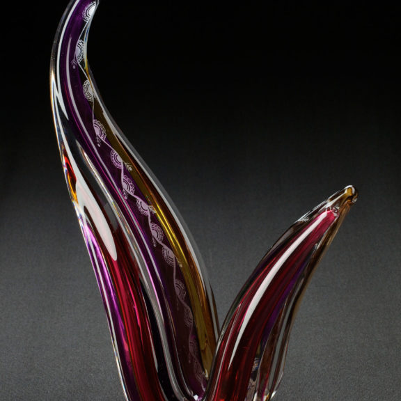 Sculpted glass ornament, purple and yellow coloured