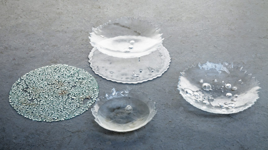 a series of glass bowls with imperfections in them caused by the riots