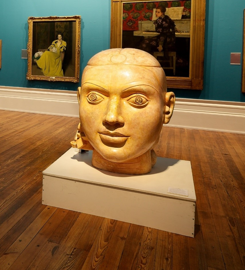 Image shows ladies head made of plaster. The head is large and is places in the centre of the Harris' art gallery.