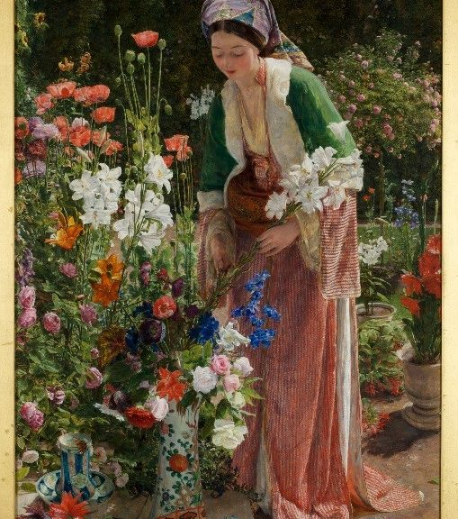 Well dressed Lady in garden tending to an array of flowers
