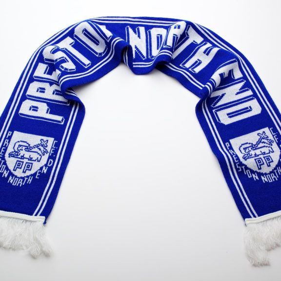 Blue football scarf with the words 'Preston North End' printed across it. Preston Crest (Preston Lamb) also printed in white on it.