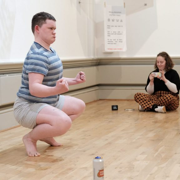 Man crouching down as a part of a perfomance