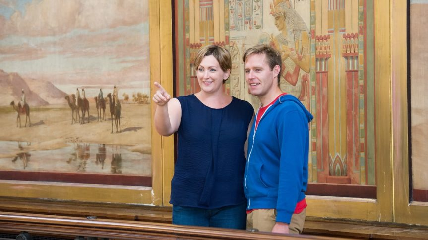A couple visiting the Egyptian Balcony at the top of the Harris building