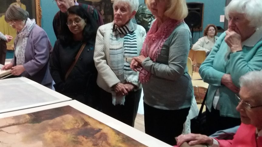 image of friends of the harris stood looking at detailed painting
