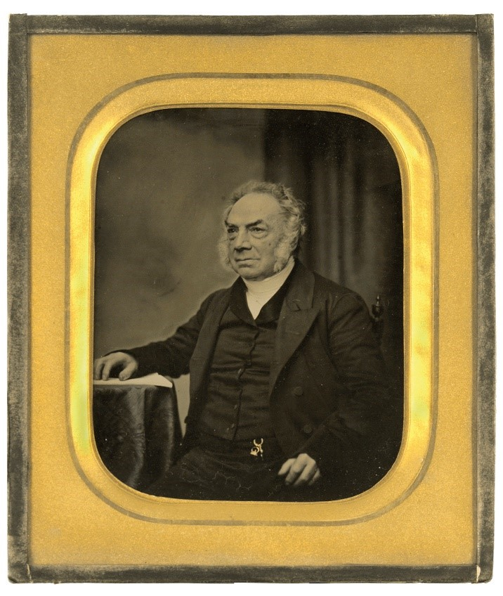 Man in old ambrotype. Ambrotype is in gold frame.