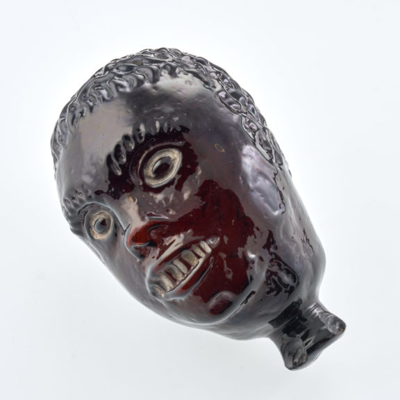 Seventeenth century head shaped scent bottle made with black glass