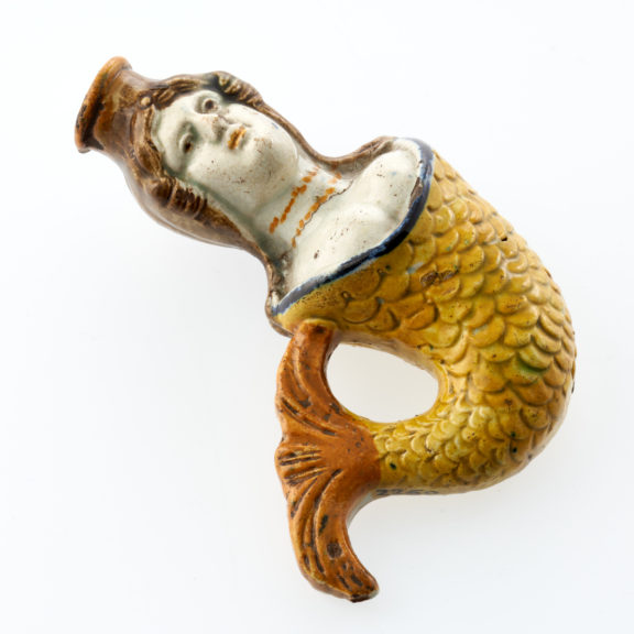 Novelty porcelain scent bottle in shape of mermaid with yellow and orange finn and brown hair