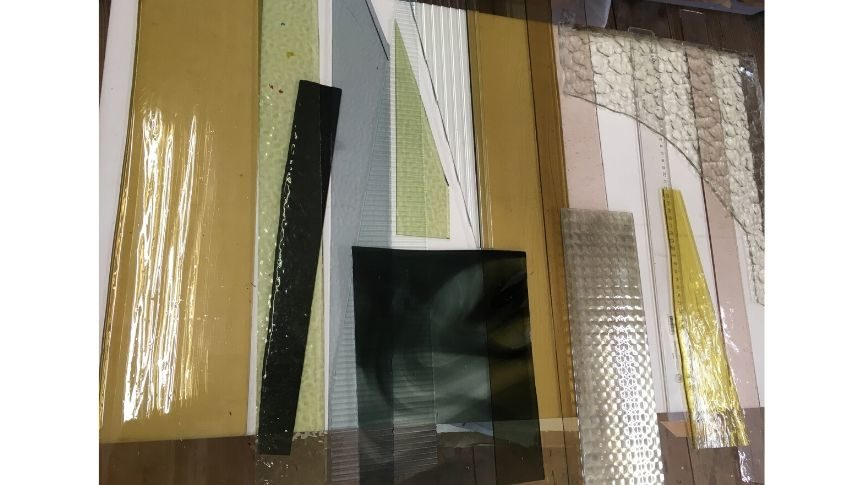 Image of Abigail Reynold's glass work. Different coloured rectangular pieces of glass laid next to each other.