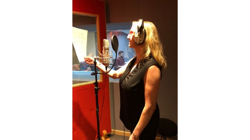 Lorraine in recording studio recording voice over for video piece