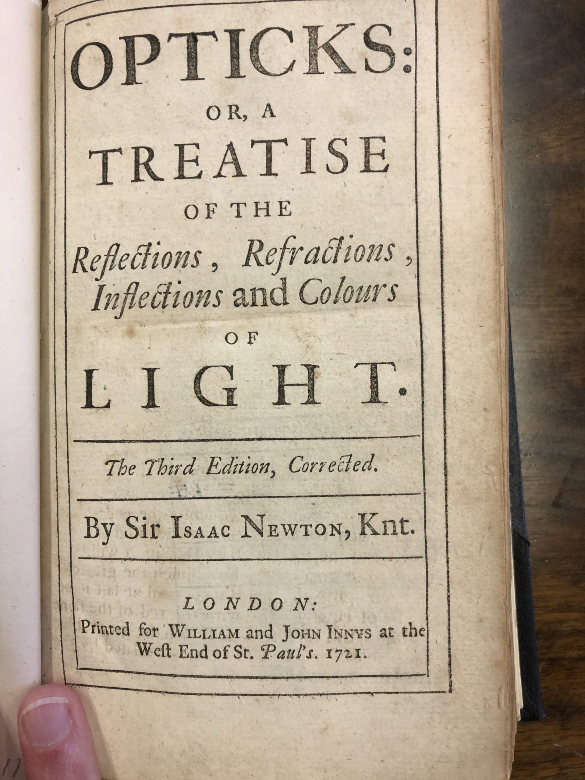 Photograph of a book by Sir Isaac Newton, printed in 1721.