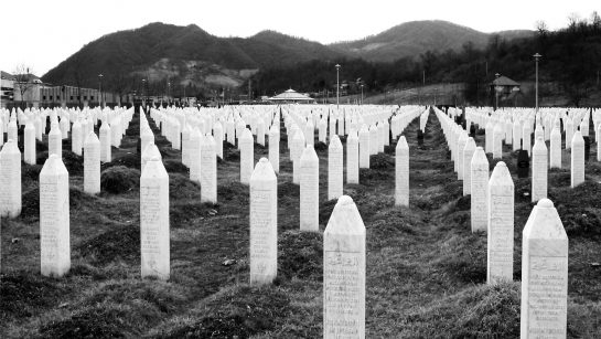 A field of white tomb stones representing those that dies in the massacre.