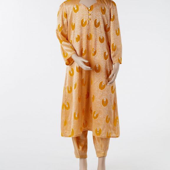 Image shows mannequin wearing Shalwar kameez, comprising of an orange tunic and trousers. It has a silver floral pattern and a scalloped neckline with three buttons at the front, long sleeves, long tunic.