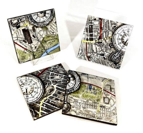 Image shows 4 coasters printed with map black and white pocket watches and maps of the streets Preston with colour illustration in places in green, red, blue and yellow.