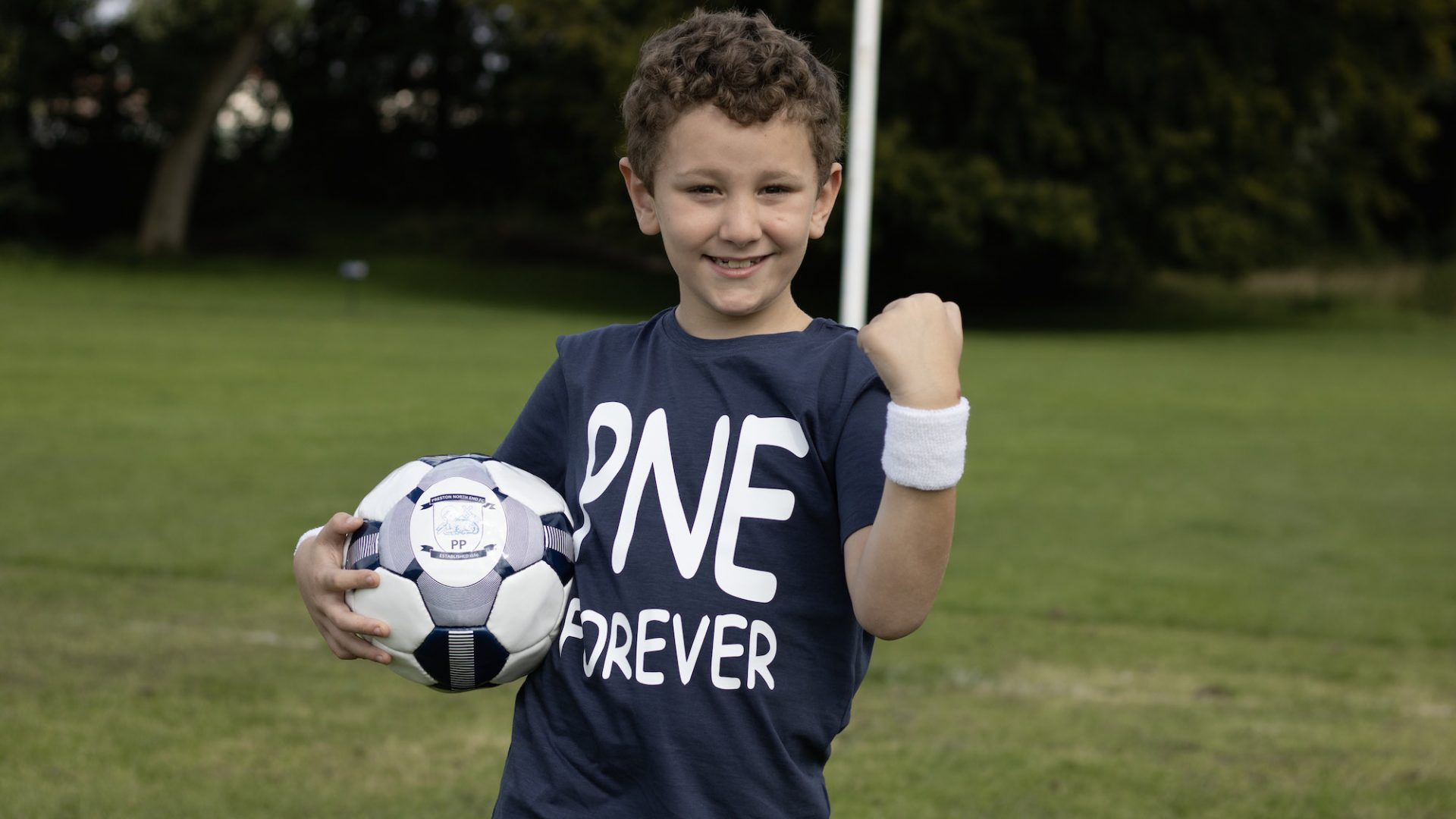 Little boy with a football and PNE shirt