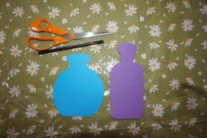 Cut out paper scent bottle shapes
