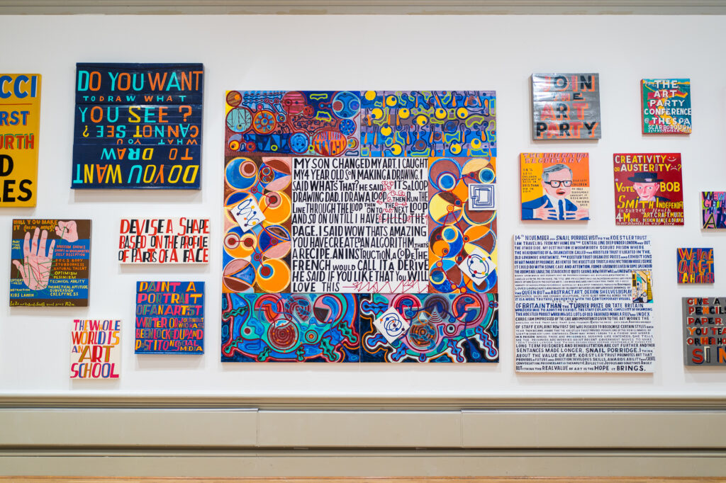 The artist Bob and Roberta's slogan style art work on the gallery wall in the Harris Art galleries