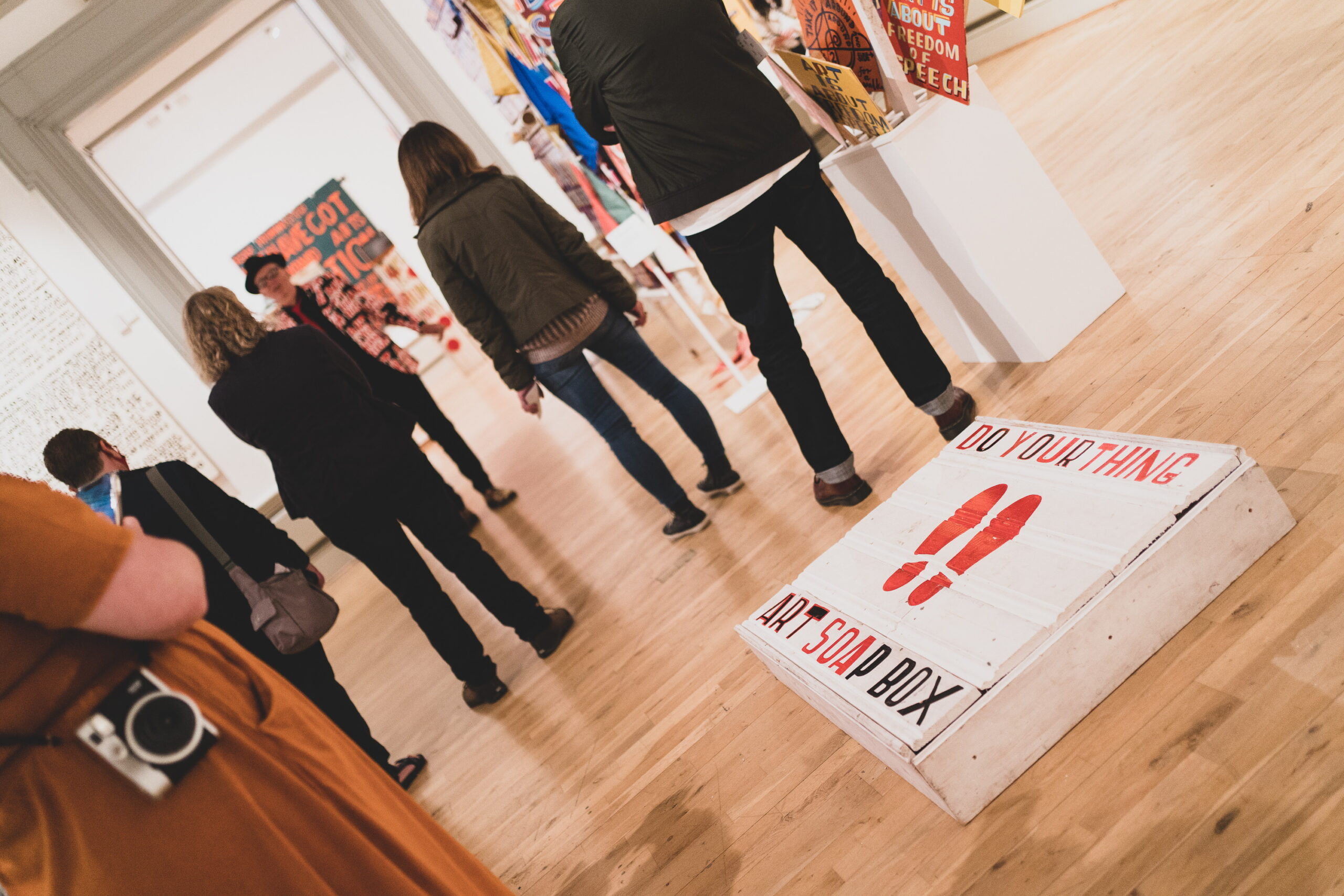 People visiting a contemporary art exhibition