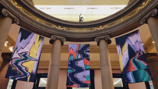 Banner artworks on display in the Harris rotunda