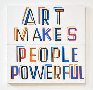 A contemporary artwork with lettering on a white board